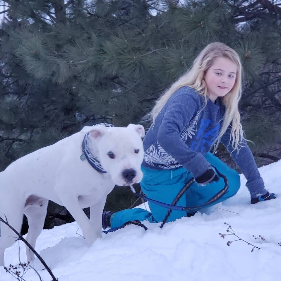 Girl Holding Rope of Dog